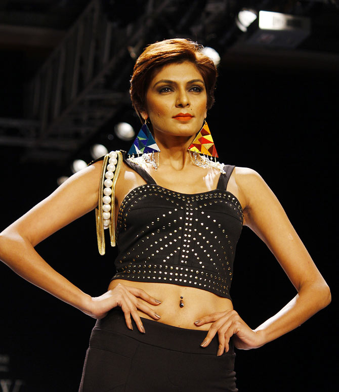 A model walks the runway for Indian Institute of Gems & Jewellery.