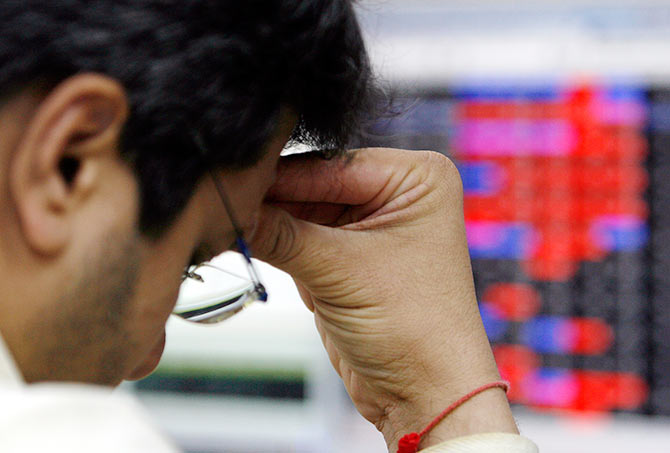 A stock broker reacts while trading at a brokerage firm in Mumbai March 13, 2008 when Indian shares fell nearly 5 per cent by Thursday afternoon to their lowest in more than six months
