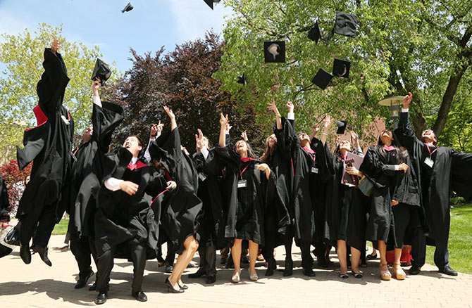 Harvard Law graduate class of 2014 throw their hats in the air on Graduation Day.