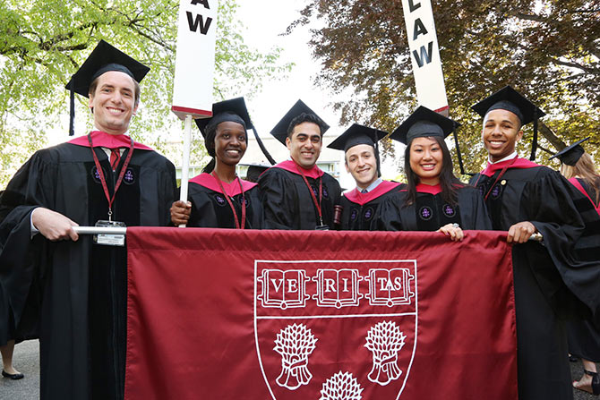 Harvard Law students pose with batchmates on their Graduation Day