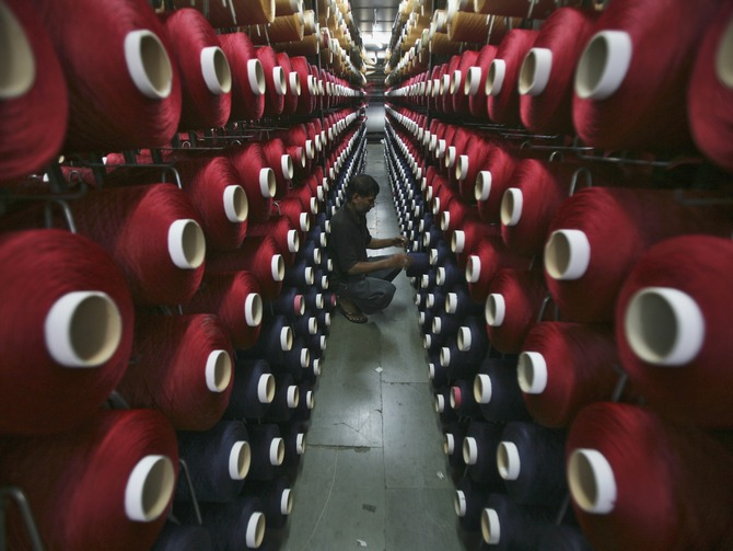 An employee works at the production line of a carpet manufacturing factory in Jammu.