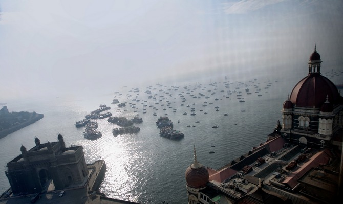 A view of the Arabian Sea with the Gateway of India on the left and a part of the Taj Mahal Hotel to the right.