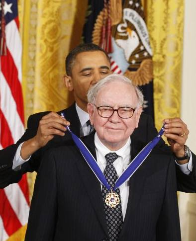 US President Barack Obama awards the Medal of Freedom to recipient Warren Buffett during a ceremony to present the awards at the White House in Washington.