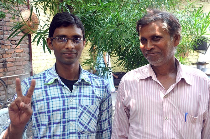 Sudhir Kumar with his father who works as a cobbler.
