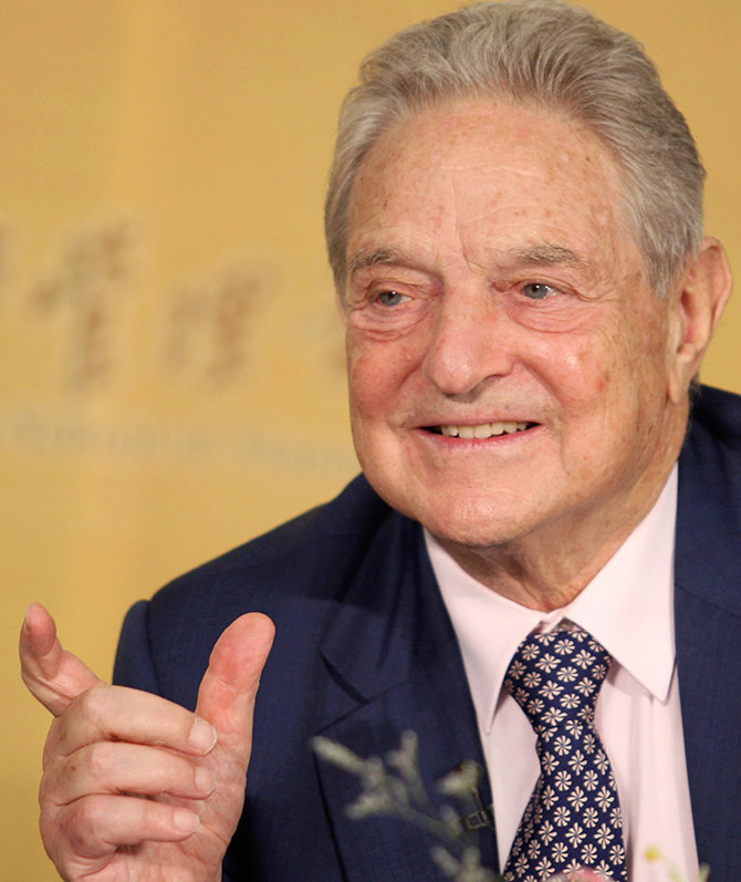 George Soros, chairman of the Soros Fund Management and Open Society, gestures during a speech at Peking University in Beijing.