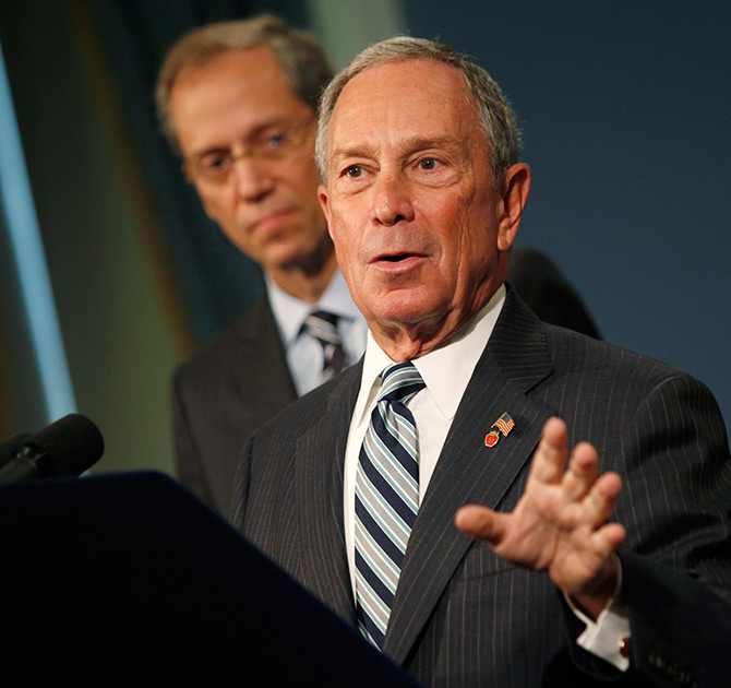 Michael Bloomberg (R) speaks alongside New York City Health Commissioner Thomas A. Farley at a news conference.