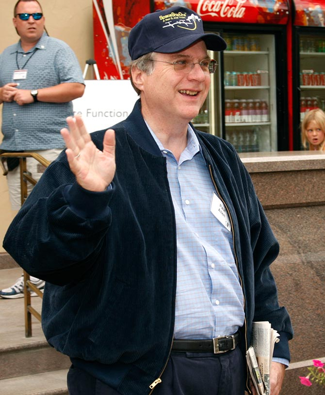 Microsoft co-founder Paul Allen waves during lunch at the Allen and Co. conference at the Sun Valley Resort in Idaho.