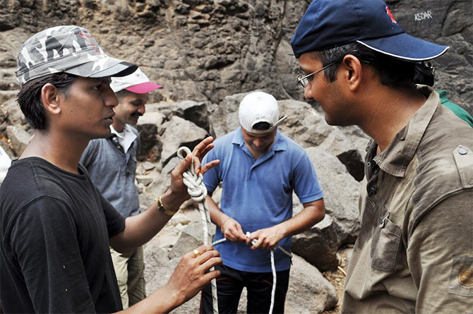 Participants learn how to use a rope at a camp organised for trekkers.