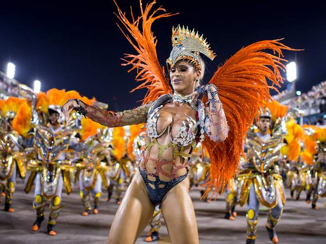 Members of Unidos da Tijuca Samba School during their parade at 2014 Brazilian Carnival at Sapucai Sambadrome in Rio de Janeiro, Brazil.