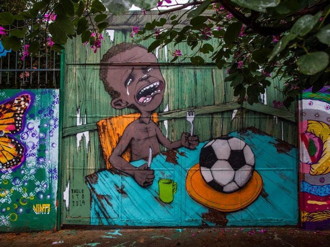 Graffiti on a wall of a public school criticises the hosting of the World Cup in Sao Paulo, Brazil.