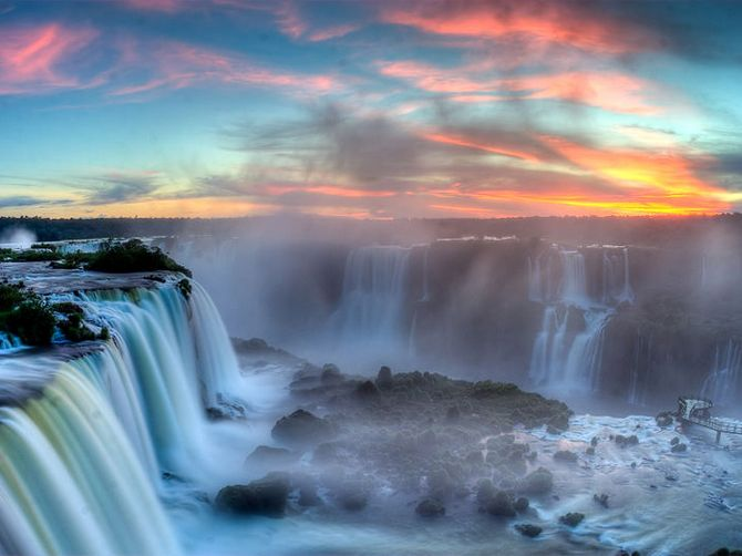 A breathtaking evening at the Iguazu Falls located on the border of the Brazilian state of Parana and the Argentinan province of Misiones.