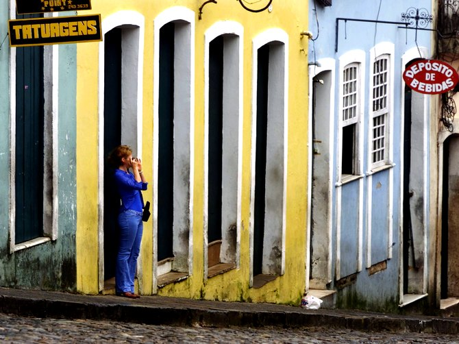A tourist takes a snapshot in the Pelourinho district of Salvador, in the northern coastal state of state of Bahia,