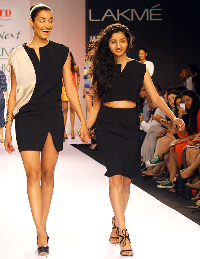 Chandni Mohan walks with a model at the end of her collection