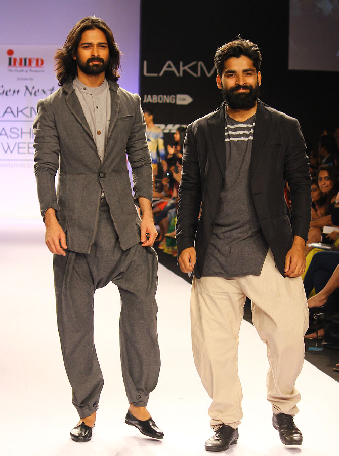 Ujjawal Dubey (right) with a model in his creation
