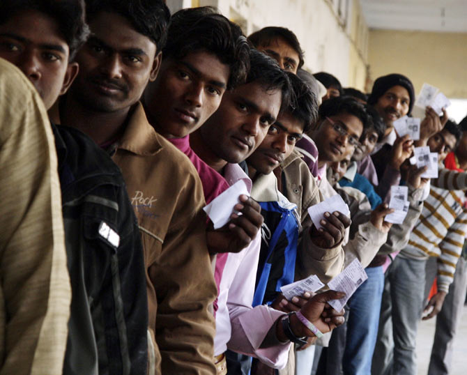 Voters wait to cast their ballots in Gorakhpur, Uttar Pradesh.