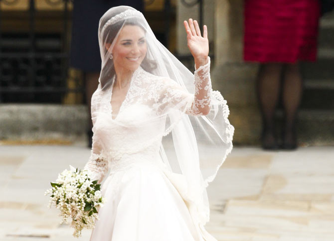 Kate waves as she arrives at Westminster Abbey for her marriage to Prince William.