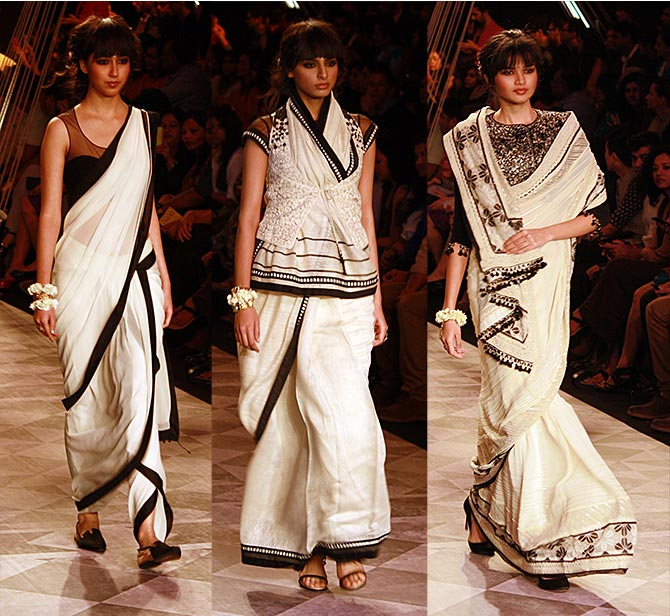Models in Tarun Tahiliani creations.