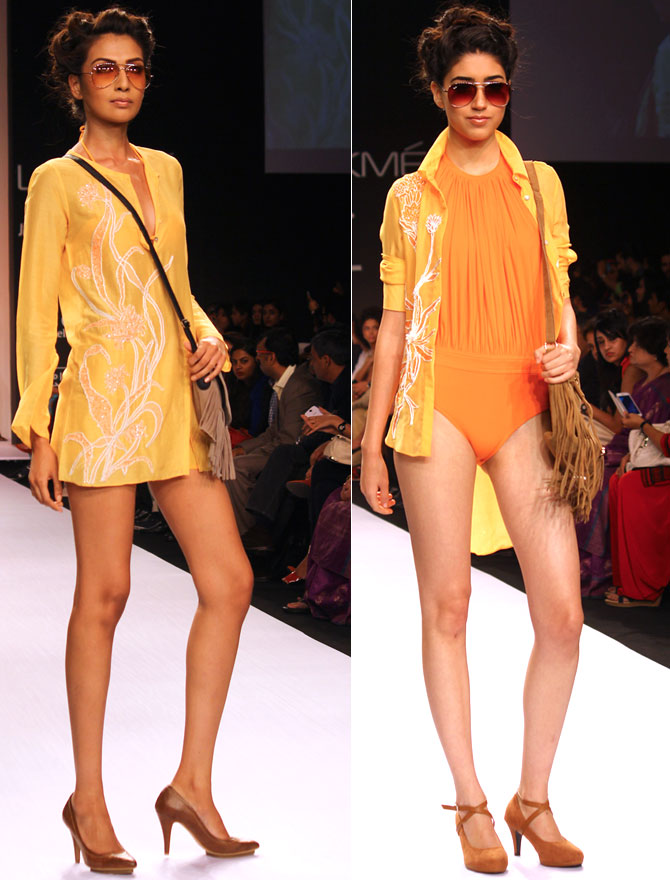 Models Sanea Shaikh and Edna Abigail present Nathwani's creations