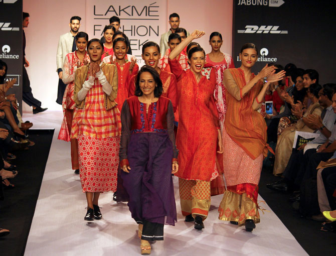 Designer Krishna Mehta on the ramp with models