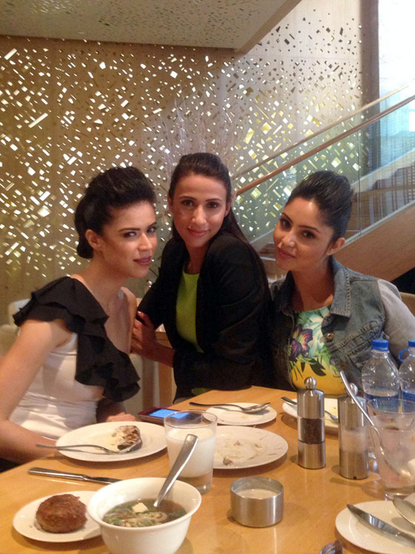Happy times: Alesia Raut bonds with her model friends over lunch.