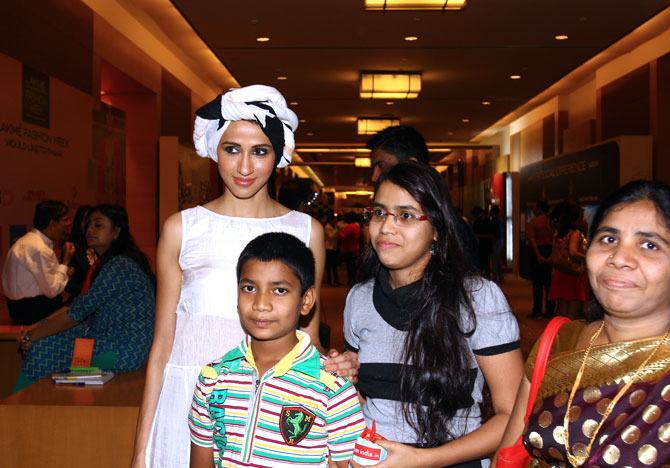 With little or no hang-ups, Alesia is one of the most easygoing people at Lakme Fashion Week. Here she poses readily with a few guests for a photograph.