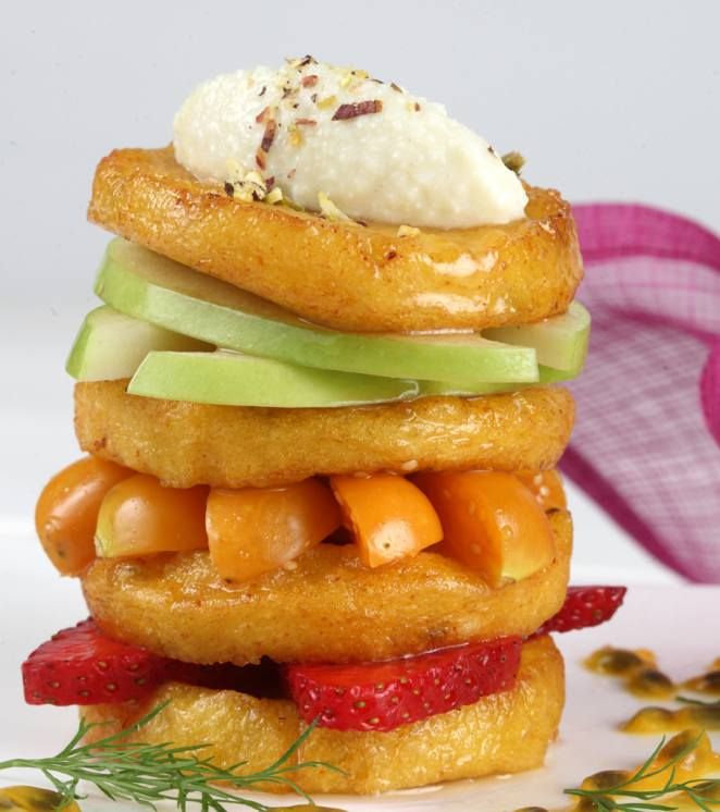 Malpua stack with fresh fruits and Rabri