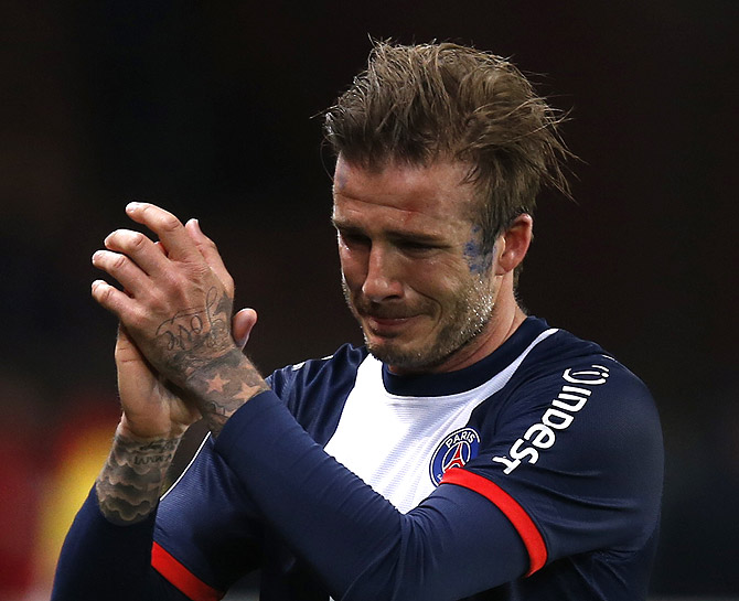 David Beckham breaks down in tears as he leaves the pitch after being substituted in the 81st minute during his team's French Ligue 1 soccer match against Brest at the Parc des Princes stadium in Paris.