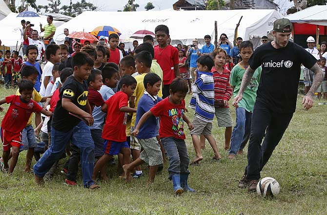 David Beckham plays soccer with typhoon survivors at an evacuation centre nearly 100 days after super Typhoon Haiyan devastated Tanauan, Leyte, in central Philippines. Beckham is one of the biggest donors to areas devastated by super typhoon Haiyan in central Philippines.