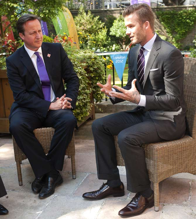 David Beckham (R) meets British Prime Minister David Cameron. Prime Minister Cameron met with Beckham to discuss their shared determination to tackle the threat of long term hunger that affects millions of children across the world.