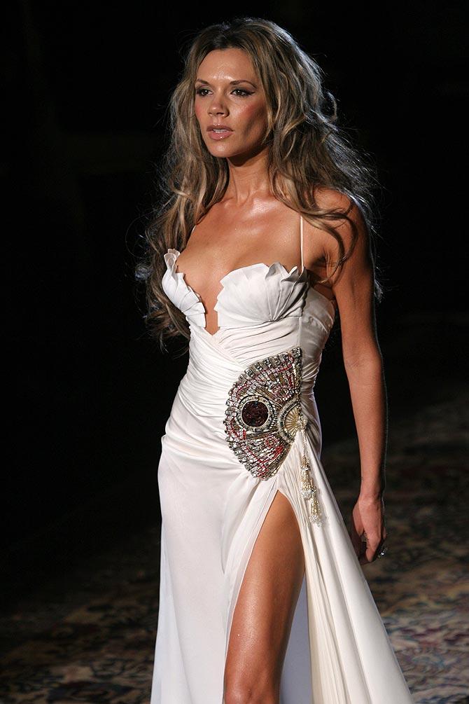 Victoria Beckham walks down the runway at the Roberto Cavalli show as part of Milan Menswear Week in Milan, Italy