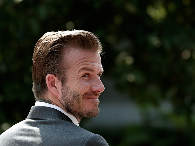 If looks could kill! David Beckham glances over his shoulder on a bright sunny morning in Beijing, China.
