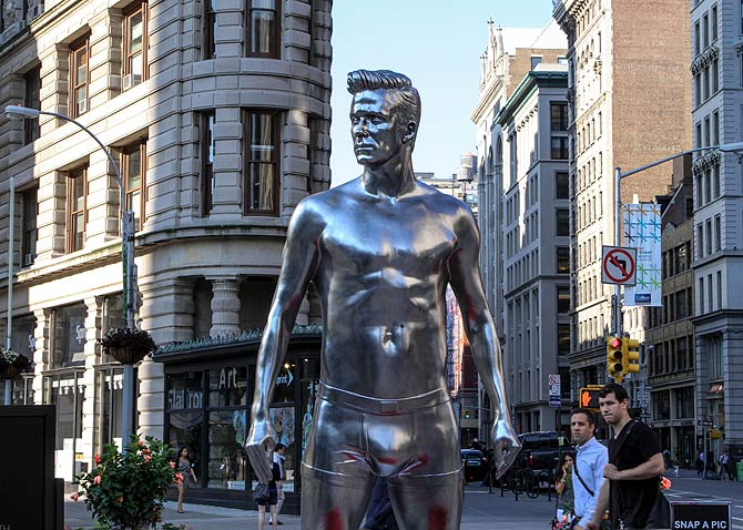 H&M Celebrates New David Beckham Ad Campaign With Statue Stunt in the Flatiron in New York City.