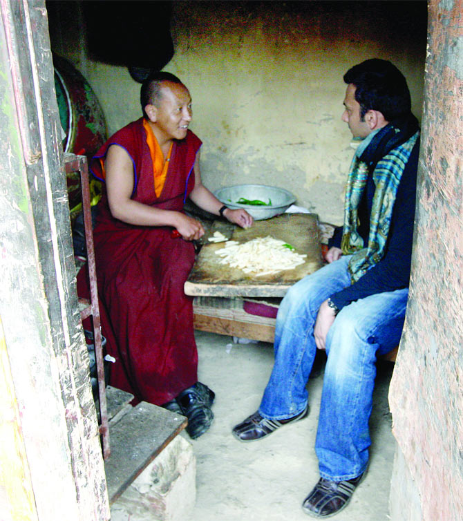 Vikas Khanna, right, discusses a recipe with a Buddhist monk.