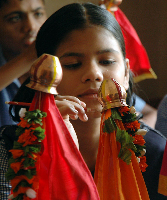 A young girl paints a gudi ahead of Gudi Padwa in Mumbai, Maharashtra
