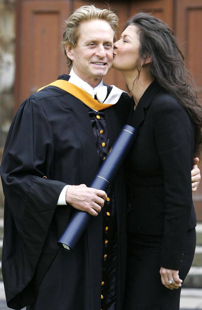 Catherine Zeta-Jones kisses her husband, US actor Michael Douglas, after he received an honorary Doctorate of Laws at St. Andrews University in Scotland June 21, 2006.
