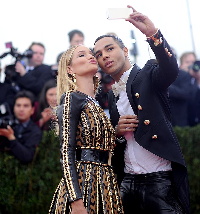 Rosie Huntington-Whiteley (L) and Olivier Rousteing