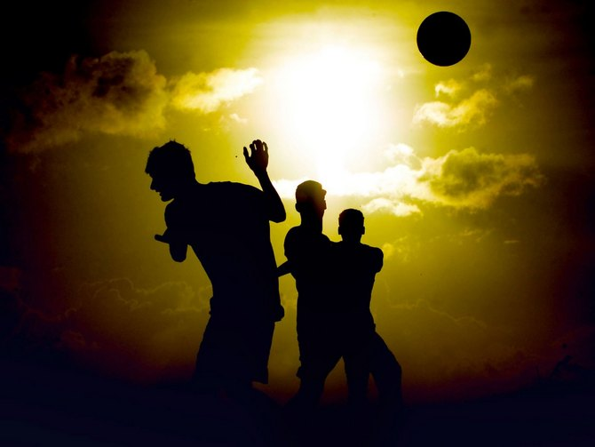Friends enjoy a game of soccer as the sun sets in the background. Image used here for representational purposes only.