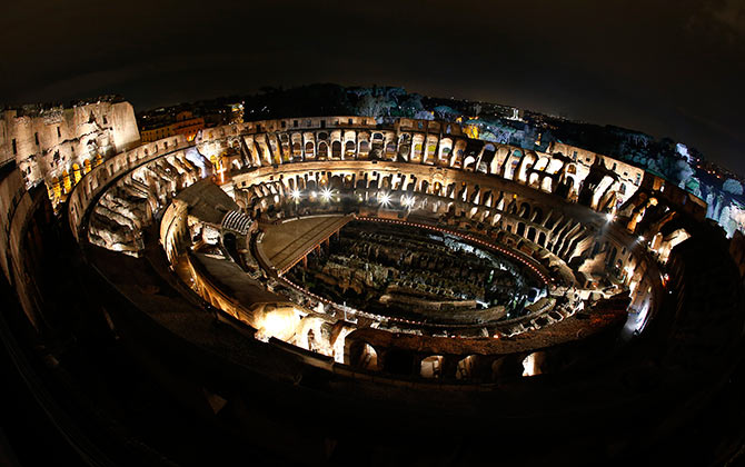 The ancient Colosseum is pictured before the Via Crucis (Way of the Cross) procession in downtown Rome.