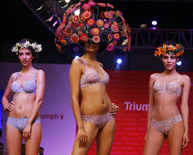 Model walk the runway in Triumph creations.