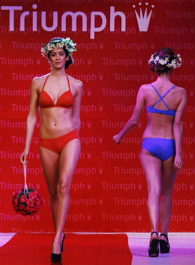 Models walk the runway in Triumph creations.