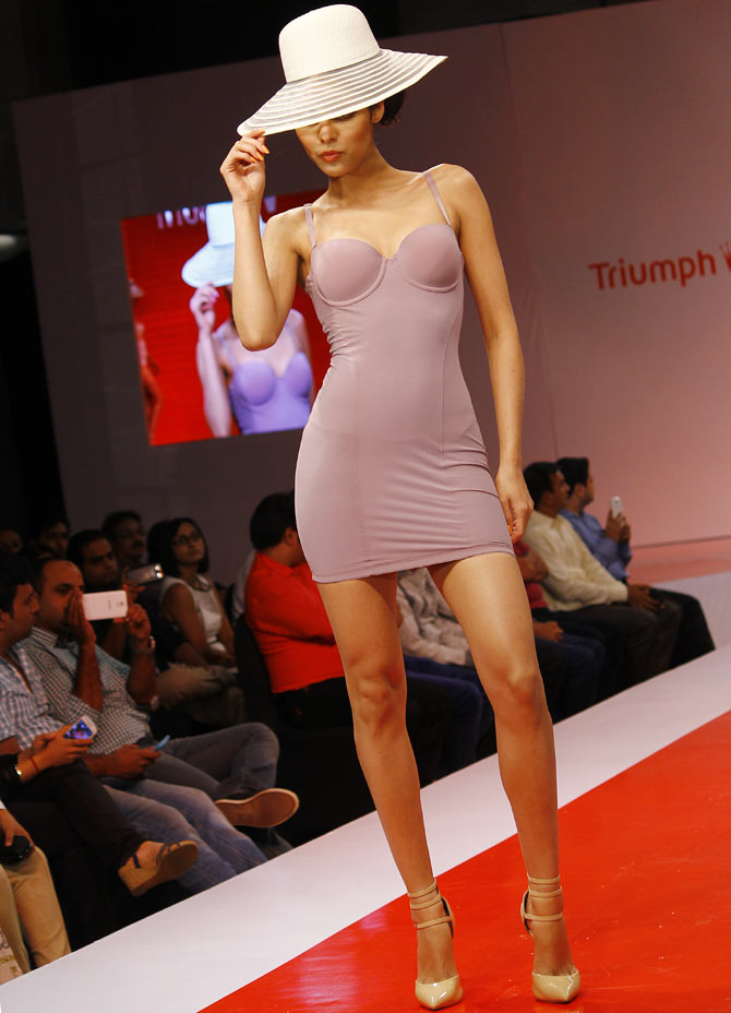 A model walks the runway in a Triumph creation.