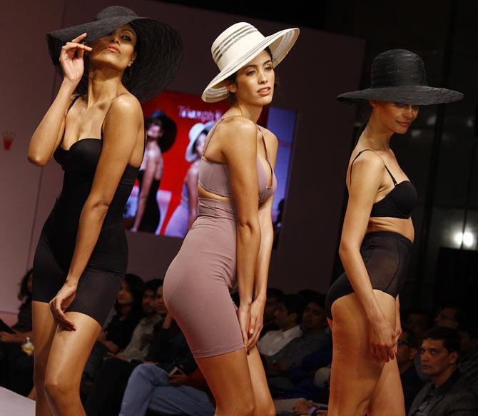 Model walk the runway in Triumph creations.