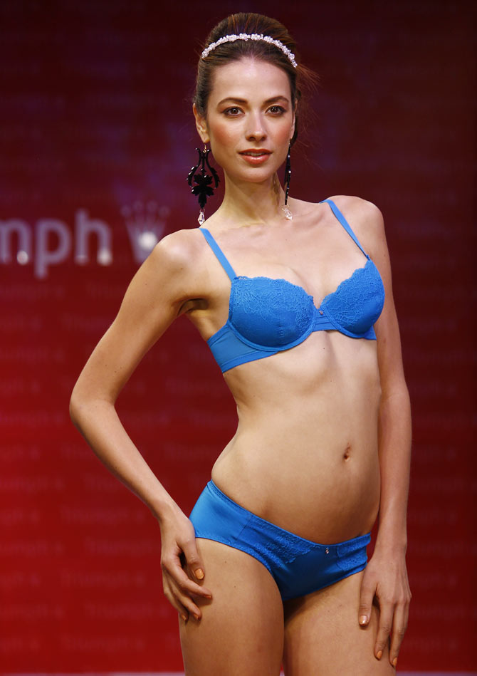 A model walks the runway in a Triumph creation.