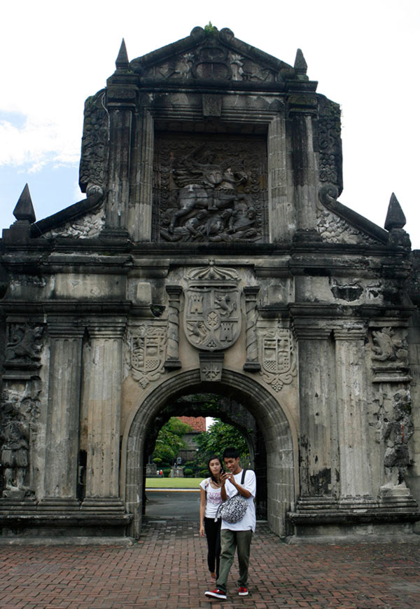 A couple takes a stroll in Fort Santiago, a fortress built by the Spanish colonizers in the 16th century in Manila's historic Intramuros
