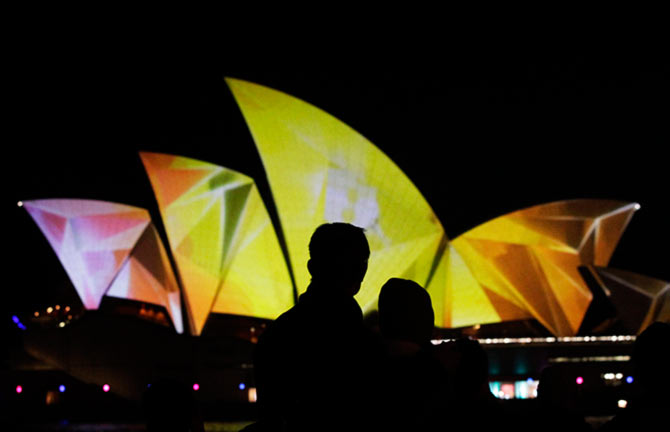 A couple looks at the Sydney Opera House