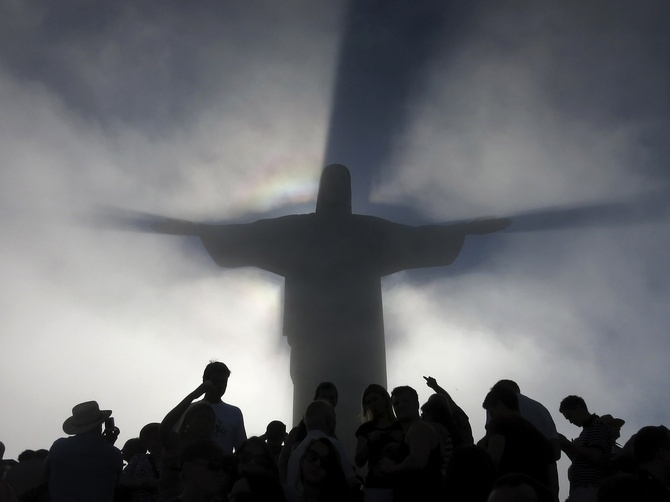 May the lord help you! Don't expect any value for money, good hotels or shopping options in Rio, say TripAdvisor users. Seen here is the statue of Christ the Redeemer casting a shadow on passing clouds atop of Corcovado mountain in Rio de Janeiro.