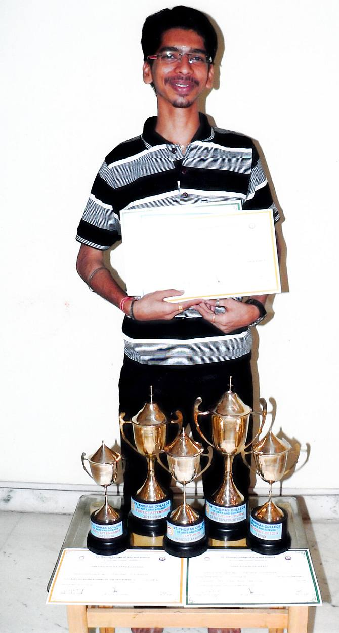Abhilash Vidyakar with his trophies at Udavum Karangal