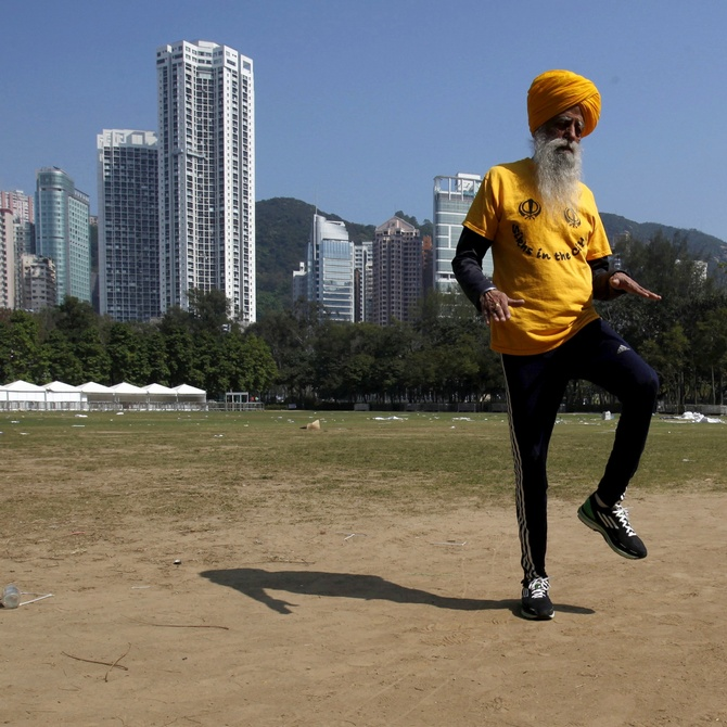 A file picture of British Indian marathon runner Fauja Singh, 101, exercising at a park in Hong Kong.