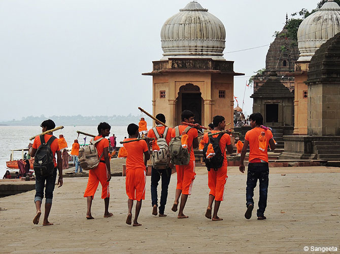 Kavad Pilgrims dressed in flaming orange