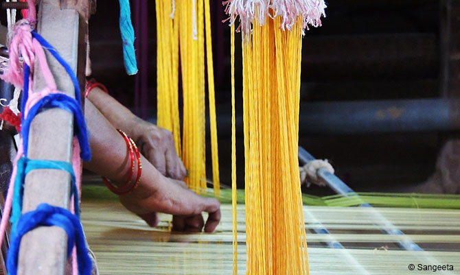 A lady at work at Maheshwari Weaving Centre